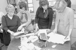PHOTOS BY JEFF GRANIT staff Margaret L. Vetter School teachers Robin Stuck (l-r), Helene White and Rosemary Simpson look through papers that were in a 50-year-old time capsule with Eatontown District Superintendent of Schools Nina Hoover.