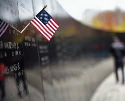 A flag hangs on the wall of names during the Veterans Day ceremony that was held at the New Jersey Vietnam Veterans' Memorial, Holmdel, Nov. 11.  STAFF PHOTOGRAPHER ERIC SUCAR