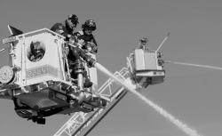 CHRIS KELLY staff Brick firefighters test ladder hoses during an emergency drill that included township fire departments and First Aid Squad members at MarineMax off Route 70 on Sunday.