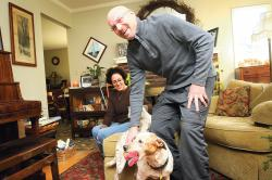 Popular Brick veterinarian Dr. Eric Hudson shares a laugh with wife Christina and his dog Annie at their Cherry Quay Road home. Friends and colleagues have rallied to help Hudson, who was diagnosed with a brain tumor in August. ERIC SUCAR staff