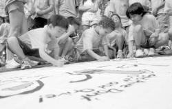 Above, children sign a banner  pledging they will not abuse drugs or alcohol.