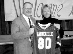 Sayreville War Memorial High School Principal James Brown presents Jon Bon Jovi with his very own Bombers jersey last week when the singer, along with a crew from ABC's 20/20, paid a visit to the school.