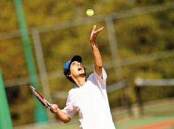 Sayreville War Memorial High School's Apoorv Kakar delivers his serve to Perth Amboy's Augie Enriquez during their April 16 match at Thomas Edison Park in Edison. Kakar's straight-set win was part of Sayreville's 5-0 victory.  JEFF GRANIT staff