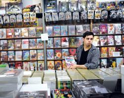 """Phillip Vazquez, 24, explains why the new comic series """"I Hate Fairyland"""" is one of his favorite new additions at The Record Store in Howell.  STAFF PHOTOGRAPHER ERIC SUCAR"""