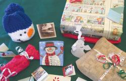 Reuse holiday items such as a festive holiday napkin used as wrapping, newsprint-wrapped gifts, burlap-wrapped gifts and gift tags cut from Christmas cards.  PHOTO COURTESY OF NANCY KRAUSS