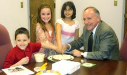 Nicholas Ryan, left to right, Julianna Marsh and Rina Thaker presented Mayor Richard Pucci with a cake in 2007 as part of a third-grade project.  PHOTOS COURTESY OF JOSEPH HARVIE