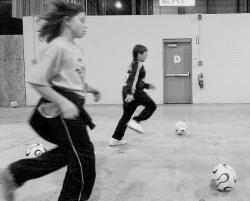 PHOTOS BY ERIC SUCAR staff Left: Kids kick a ball around the Kid Zone at the New Jersey Youth Soccer Organization Expo held at the N.J. Convention Center in Edison on Saturday. The expo included coaching workshops, various vendor exhibitions and more than a dozen clinics throughout the day.Above: U.S.Men's National Team and member of the New Jersey Ironmen TonyMeola talks about his soccer career to the large crowd gathered at the expo. The expo included coaching workshops, various vendor exhibitions and more than a dozen clinics throughout the day.