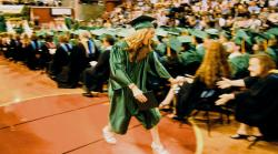 Above: Jillian Earley receives congratulations at the J.P. Stevens High School graduation on June 18. Right: Danielle Darrell Gainer gets a laugh at the ceremony.