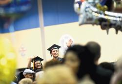 Members of the 2011 graduating class at Middlesex County College, Edison, wave to the audience during the school's 44th annual commencement ceremony May 19.  JEFF GRANIT staff