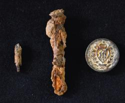 Two nails and a 19th-century button were recovered during the metal detector survey at Piscatawaytown.