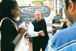 Pete Leonard of First Class Limousines, Marlboro, explains his services to a listening crowd during the American Bridal Show at the Menlo Park Mall in Edison July 26.  SCOTT FRIEDMAN