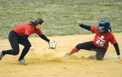 Bishop Ahr High School's Gabby Elvina slides safely into second base ahead of the tag of Allentown second baseman Jame Minar during a March 28 preseason scrimmage in Edison. The scholastic season officially opens this week for Bishop Ahr. The Trojans will host North Brunswick on April 5 at 4 p.m.  ERIC SUCAR staff