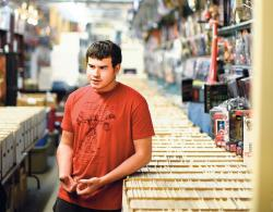 Standing in the main aisle of long boxes packed with comic books, Adam Nieves, 19, of Toms River, discusses his love for the medium.  STAFF PHOTOGRAPHER ERIC SUCAR