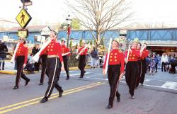 The annual Winter Festival Parade ushers in the holiday season as it marches on Main Street, Metuchen, on Nov. 29.  COURTESY OF DAVID GLASOFER