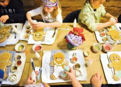Grocery stores are offering more than food shopping such as this gingerbread cookie decorating class held at Whole Foods Market in Marlboro on Dec. 17.  STAFF PHOTOGRAPHER ERIC SUCAR
