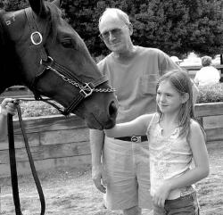FARRAH MAFFAI Kristin Shortell, Jackson, and her grandfather, Ed VanPelt, Allentown, stop to pet DVC Va Va Voom, one of the many horses at the Festival of Horses held at the Horse Park of New Jersey in Upper Freehold Sunday.