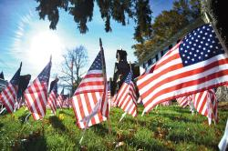 An Honor Garden at the Eatontown Historical Museum pays tribute to veterans and active-duty service members during a Nov. 2 ceremony held in advance of Veterans Day, Nov. 11.  SCOTT FRIEDMAN
