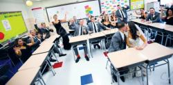 On their wedding day, Kristin and Anthony Mangine revisited the classroom where they met as pupils at the Barkalow Middle School, Freehold Township. Several members of the wedding party were classmates of the couple at the school.  aCLB PHOTOGRAPHY