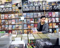"Phillip Vazquez, 24, explains why the new comic series ""I Hate Fairyland"" is one of his favorite new additions at The Record Store in Howell.  STAFF PHOTOGRAPHER ERIC SUCAR"