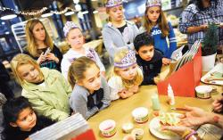 Children of all ages watch a gingerbread cookie demonstration by Dani B. Fiori at Whole Foods Market in Marlboro on Dec. 17.  STAFF PHOTOGRAPHER ERIC SUCAR