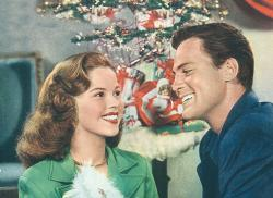 Child star Shirley Temple and John Agar were happy newlyweds at Christmastime in 1945.
