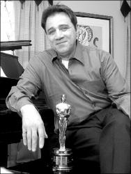 "JERRY WOLKOWITZ  Franke Previte shows off the Academy Award he won in 1987 for the song ""(I've Had) the Time of My Life"" from the movie Dirty Dancing. At right is the platinum record that hangs in his Middletown home."