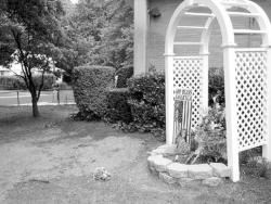 ELAINE VAN DEVELDE A 51/2-foot-tall statue of the Virgin Mary that stood underneath this arbor at St. Catherine's was allegedly beheaded by teen vandals July 19. The desecrated statue was buried next to the arbor July 22 as part of a Catholic ceremony for disposing of sacred objects.