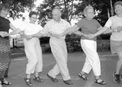 FARRAH MAFFAI Monmouth Folk Dancers Nelly Seigal, Tinton Falls, David Reisman, Hazlet, and Alize Boyarin, Lakewood, learn the steps to the Juego, a Romanian folk dance.