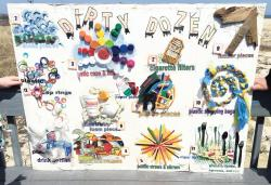 """The """"Dirty Dozen,"""" a poster of the top 12 types of debris littering beaches, was on display during an April 13 press conference on Sandy Hook held by Clean Ocean Action.  KENNY WALTER/STAFF"""