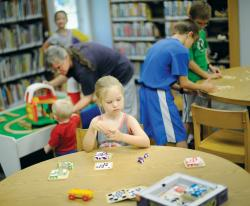 Elizabeth Prioli, 6, a home-schooled student, plays a game at the Howell Public Library on Aug. 21.  STAFF PHOTOGRAPHER ERIC SUCAR