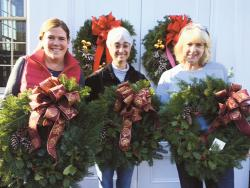 Christmas Greens co-chair Liz Dusko, left to right, Rumson Garden Club President Diane Guidone and Christmas Greens co-chair Angela Benin proudly display some of the wreaths donated to local non-profits this year.  PHOTO COURTESY OF RUMSON GARDEN CLUB