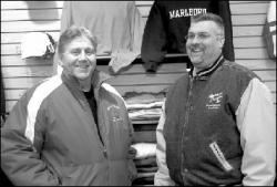 FARRAH MAFFAI Steve Barnett (l) and Todd Berman, owners of Apparel Zone on Main Street in Matawan, stand inside their store which screenprints T-shirts and does embroidery work for clients that include local sports teams, religious organizations and schools.