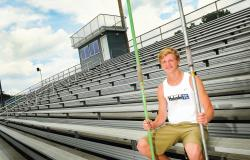 Holmdel High School's Eric Williams, a 2013 graduate, holds the two javelins he cherished. The one on his right was the one he used in setting the school record this spring, and the one on his left was used by the late Bob Roggy in competition. Roggy's javelin was given to him by Scott Cannon, his throwing coach at Holmdel and a friend of Roggy. Roggy set the American record in the javelin in 1982 and was ranked No. 1 in the world.  STAFF PHOTOGRAPHER ERIC SUCAR