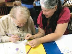 Brandywine Senior Living resident Alice Leach and A Stroke of Creativity owner Patty Lang work together on a ceramics project at the Monroe studio.