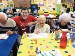 Brandywine resident Kirt Wedemeyer, left to right, A Stroke of Creativity owner Bob Lang, resident Nancy Pike and resident Harriet Strauss work together on a project.