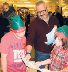 A.J. Silvestri, a sixth-grader at Carl Sandburg Middle School, reads one of the letters with Superintendent of Schools David Cittadino.