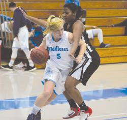 Middlesex County College's Brittany Clayton, left, dribbles around the Community College of Philadelphia's Saviare Gilliam during a recent game in Edison. The Middlesex women's basketball team is having a great season. The women are 12-1 overall and in first place in the Garden State Athletic Conference and Region 19.  SCOTT FRIEDMAN