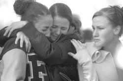 JEFF GRANIT staff Freehold High School students console each other on Jan. 11 as they visit the site on Kozloski Road, Freehold Township, where fellow students Michael Dragonetti, Andrew Lundy and James Warnock were killed in an accident on Jan. 10.