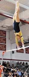 Freehold High School gymnast Danielle Verdon performs on the uneven bars during the Central Jersey Section I meet on Nov. 5. Verdon placed second on uneven bars and second in the all-around competition as she helped the Colonials repeat as the Central Jersey Section I team champions.  DORINE SHAPIRO