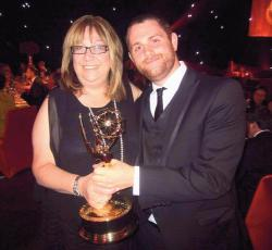 Old Bridge High School graduate Adam Chazen shares his Emmy award with his mom, Michele.
