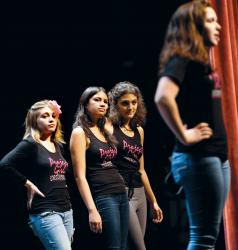 Tiff Roma (l-r), Isabella Olaguera, Aya Abdelaziz and Tess Cronin, of the Project Girl Performance Collective, act out a bullying scenario on Oct. 2 during an empowerment program presented as part of the Week of Respect at Red Bank Regional High School in Little Silver.  JEFF GRANIT staff