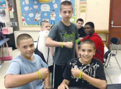 Jackson students show off their commemorative wristbands, signifying that they've made a pledge to stand up against bullying in their schools.  PHOTO PROVIDED BY JACKSON SCHOOL DISTRICT