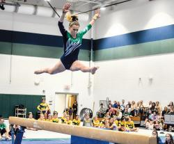 Colts Neck High School's Sophie Garito is airborne during her balance beam routine at a dual meet against Red Bank Catholic High School Oct. 13 in Colts Neck. RBC edged the Cougars in the duel between undefeated teams.  MATT DENTON