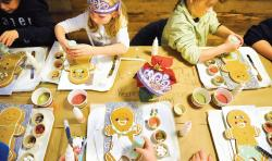 Today, grocery stores are offering more than just aisles of food to customers, as illustrated by this gingerbread cookie decorating class that was held at Whole Foods Market, Marlboro, on Dec. 17.  STAFF PHOTGRAPHER ERIC SUCAR