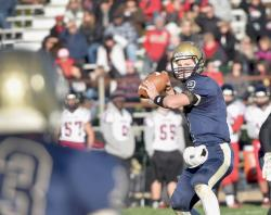 Freehold High School quarterback Jake Curry was a dual threat this fall with his passing and running, which helped the Colonials reach the state playoffs for a second consecutive season.  SCOTT FRIEDMAN