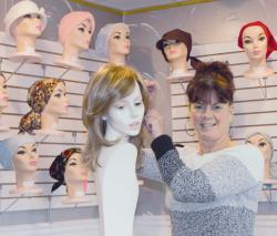 Lucy Melillo is the second-generation owner of Wig Illusions, Manalapan, which offers products to individuals who are battling diseases that result in hair loss.  JENNIFER ORTIZ/STAFF