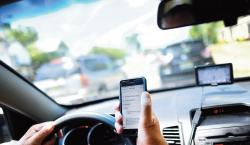 Distracted driving, whether it involves a motorist on a cell phone, eating a sandwich, applying makeup or shaving, takes a dangerous toll on New Jersey's roads.  PHOTO ILLUSTRATION BY STAFF PHOTOGRAPHER ERIC SUCAR