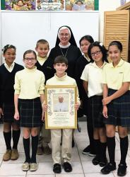 Sister Cherree Power and pupils at the St. Veronica School, Howell, display the papal blessing the school received from Pope Francis on the occasion of its 50th anniversary.  JENNIFER ORTIZ/STAFF