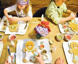 Today, grocery stores are offering more than just aisles of food to customers, as illustrated by this gingerbread cookie decorating class that was held at Whole Foods Market, Marlboro, on Dec. 17.  STAFF PHOTOGRAPHER ERIC SUCAR